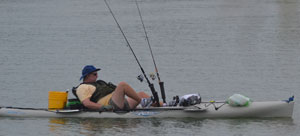 Man on kayak with fishing setup